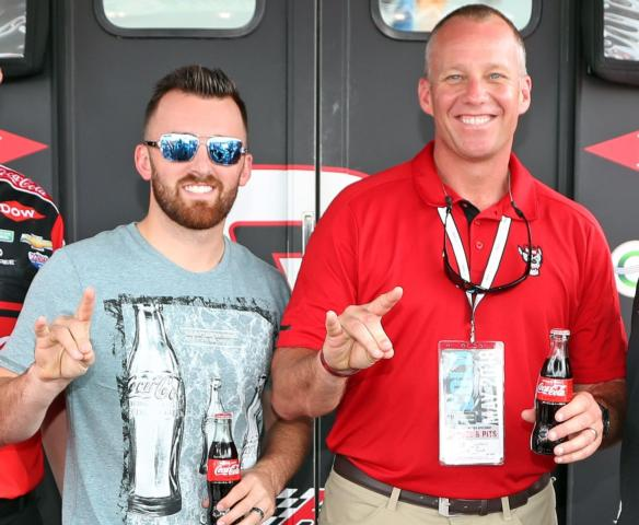 North Carolina State head football coach Dave Doeren, right, met defending Coca-Cola 600 winner Austin Dillon on Sunday prior to the 59th running of the Coca-Cola 600 at Charlotte Motor Speedway.