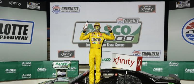 Joe Gibbs Racing driver Kyle Busch held off Austin Cindric to win Monday's Alsco 300 at Charlotte Motor Speedway.