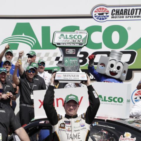 Tyler Reddick celebrates after winning Saturday's Alsco 300 at Charlotte Motor Speedway.