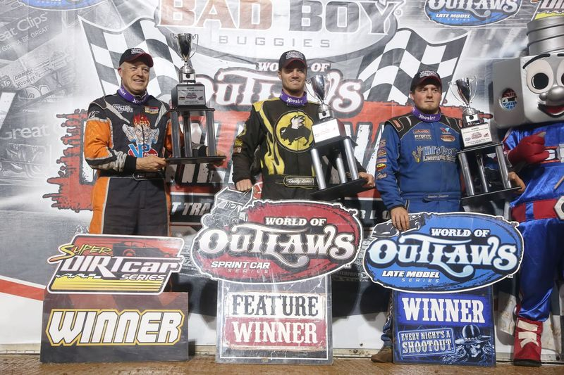 Danny Johnson, Dusty Zomer and Brandon Sheppard celebrate Friday feature wins at the Bad Boy Buggies World of Outlaws World Finals at The Dirt Track.