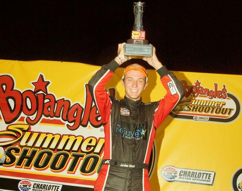 Jordan Black celebrates after winning the In Light Wellness Legend Car Pro feature during Bojangles' Summer Shootout on Tuesday at Charlotte Motor Speedway.