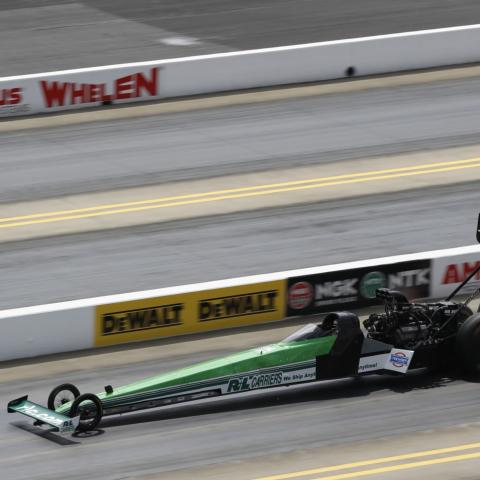 Part-time NHRA Top Fuel driver Josh Hart knocked off No. 1 qualifier Brittany Force to win the Top Fuel portion of Sunday's DEWALT NHRA Carolina Nationals at zMAX Dragway.