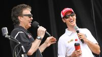 Radio personality Paul Schadt and NASCAR driver Joey Logano share a laugh during the Coca-Cola 600 pre-race pit party at at Charlotte Motor Speedway.