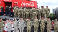 Military members stand and salute during the pre-race festivities at the Coca-Cola 600 at Charlotte Motor Speedway.