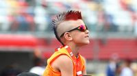 A young fan watches the pre-race festivities before the 57th running of the Coca-Cola 600 at Charlotte Motor Speedway.