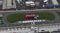 Drivers roll across the start/finish line to start the Coca-Cola 600 at Charlotte Motor Speedway.
