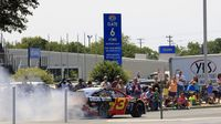 NASCAR Sprint Cup Series driver Austin Dillon does a burnout in front of cheering fans during the seventh annual Parade of Power at Charlotte Motor Speedway on Wednesday.