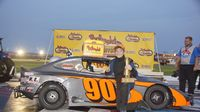 Daniel Wilk poses for a photo after his sixth consecutive Bandolero Bandit win Tuesday during Round 6 of the Bojangles' Summer Shootout at Charlotte Motor Speedway.