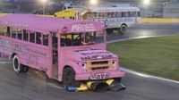 School buses race through Turn 4 during Round 6 of the Bojangles' Summer Shootout at Charlotte Motor Speedway.