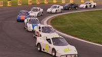 A pack of Bandoleros heads down the frontstretch of Charlotte Motor Speedway's quarter-mile during Round 6 of the Bojangles' Summer Shootout at Charlotte Motor Speedway.