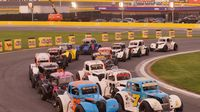 Semi-Pro drivers race side-by-side on a restart during Round 6 of the Bojangles' Summer Shootout at Charlotte Motor Speedway.