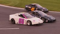 Bandoleros race three-wide during Round 6 of the Bojangles' Summer Shootout at Charlotte Motor Speedway.